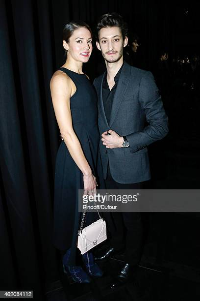 Actors Pierre Niney and his Companion Natasha Andrews attend the Dior Homme Menswear Fall/Winter 20152016 Show as part of Paris Fashion Week on...