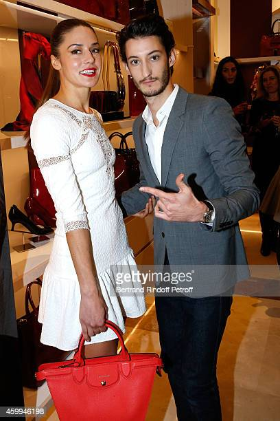 Actors Pierre Niney and his Fiance Natasha Andrews attend the Longchamp Elysees 'Lights On Party' Boutique Launch on December 4 2014 in Paris France