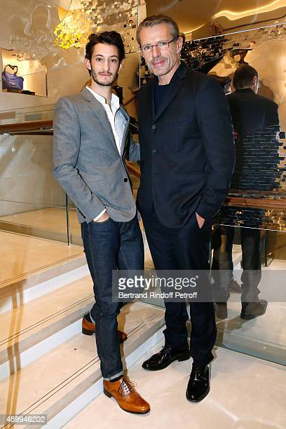 Actors Pierre Niney and Lambert Wilson attend the Longchamp Elysees 'Lights On Party' Boutique Launch on December 4 2014 in Paris France