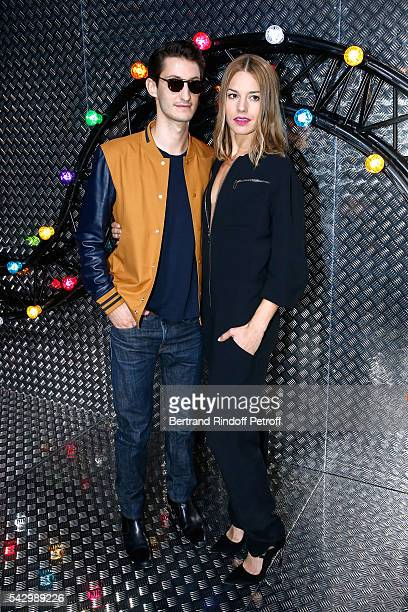 Actors Pierre Niney and Natasha Andrews attend the Dior Homme Menswear Spring/Summer 2017 show as part of Paris Fashion Week on June 25 2016 in Paris...