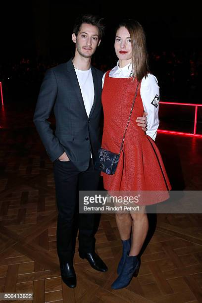 Actors Pierre Niney and Natasha Andrews attends the Dior Homme Menswear Fall/Winter 20162017 show as part of Paris Fashion Week on January 23 2016 in...