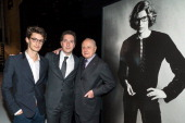 Actors Pierre Niney Guillaume Gallienne and entrepreneur Pierre Berge pose by a photo of late fashion designer Yves Saint Laurent by photographer...