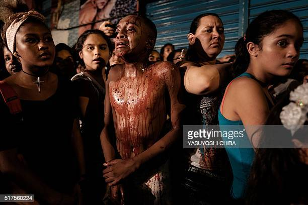 Actors play Via Sacra da Rocinha blended with their current issue murders of black youths in favela along the road at Rocinha community in Rio de...