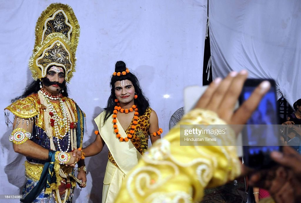 Actors playing Ravana and Ram in Ramlila pose for picture backstage at Noida stadium on October 11, 2013 in Noida, India. Ramlila is a dramatic folk re-enactment of the life of Hindu Lord Rama's victory after a ten day battle with the ten headed Demon King Ravana.