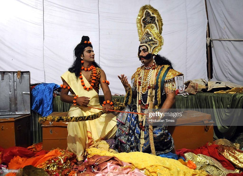 Actors playing Ravana and Ram in Ramlila talk at backstage at Noida stadium on October 11, 2013 in Noida, India. Ramlila is a dramatic folk re-enactment of the life of Hindu Lord Rama's victory after a ten day battle with the ten headed Demon King Ravana.