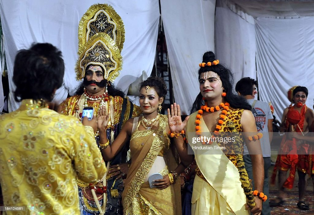Actors playing Ravana, Ram and Sita in Ramlila pose for picture backstage at Noida stadium on October 11, 2013 in Noida, India. Ramlila is a dramatic folk re-enactment of the life of Hindu Lord Rama's victory after a ten day battle with the ten headed Demon King Ravana.
