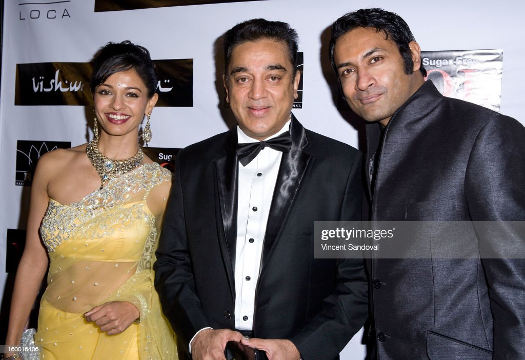 Actors Pooja Kumar Kamal Hassan and Samrat Chakrabarti attend the premiere of 'Vishwaroopam' at Pacific Theaters at the Grove on January 24 2013 in...