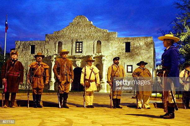 Actors portraying defenders of the Alamo stand in front of the structure during a reenactment of the fall of the Alamo March 6 to Mexican forces...