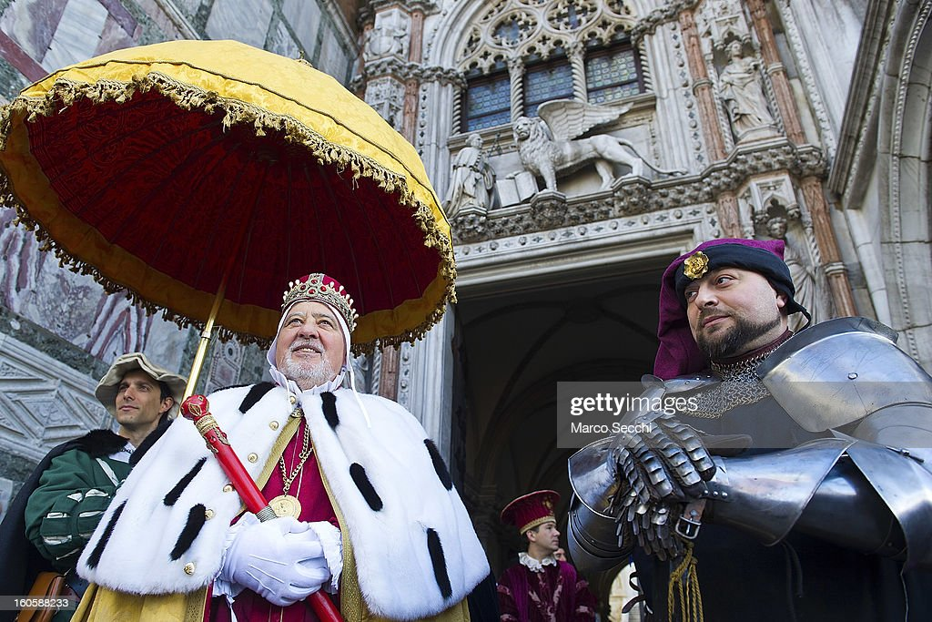 Actors pose for pictures in front of the Doge Palace minutes ahead the official opening of the Venice Carnival 2013 on February 3, 2013 in Venice, Italy. The 2013 Carnival of Venice will run from January 26 - February 12 and includes a program of gala dinners, parades, dances, masked balls and music events.
