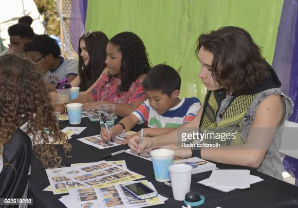 Actors Prophet Bolden Jaheem Toombs Lilimar Laya Deleon Hayes Evan Kishiyama and Dalton Cyr sign autographs at 17th Annual Children's Earth Day...