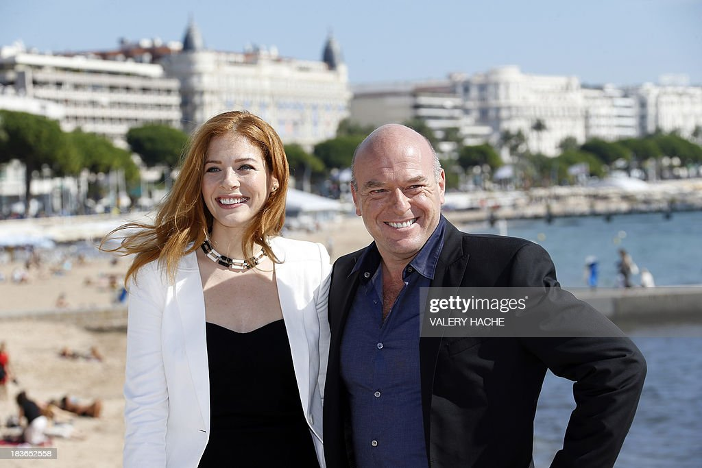 US actors Rachelle LeFevre (L) and Dean Norris (R) pose during a photocall for a TV show 'Under the Dome' as part of the MIPCOM audiovisual trade fair on October 8, 2013 in Cannes, southeastern France.