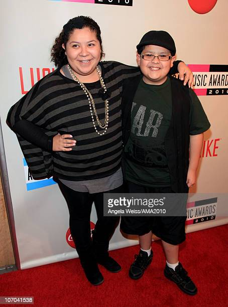 Actors Raini Rodriguez and Rico Rodriguez attend the 2010 American Music Awards preparty charity bowl tournament held at Lucky Strike Lanes at NOKIA...