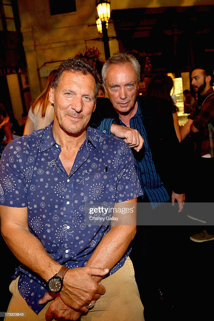 Actors Ralf Moller and Udo Kier attend the Porsche Design and Vogue re-opening event at Porsche Design Beverly Hills on July 11, 2013 in Beverly Hills, California.