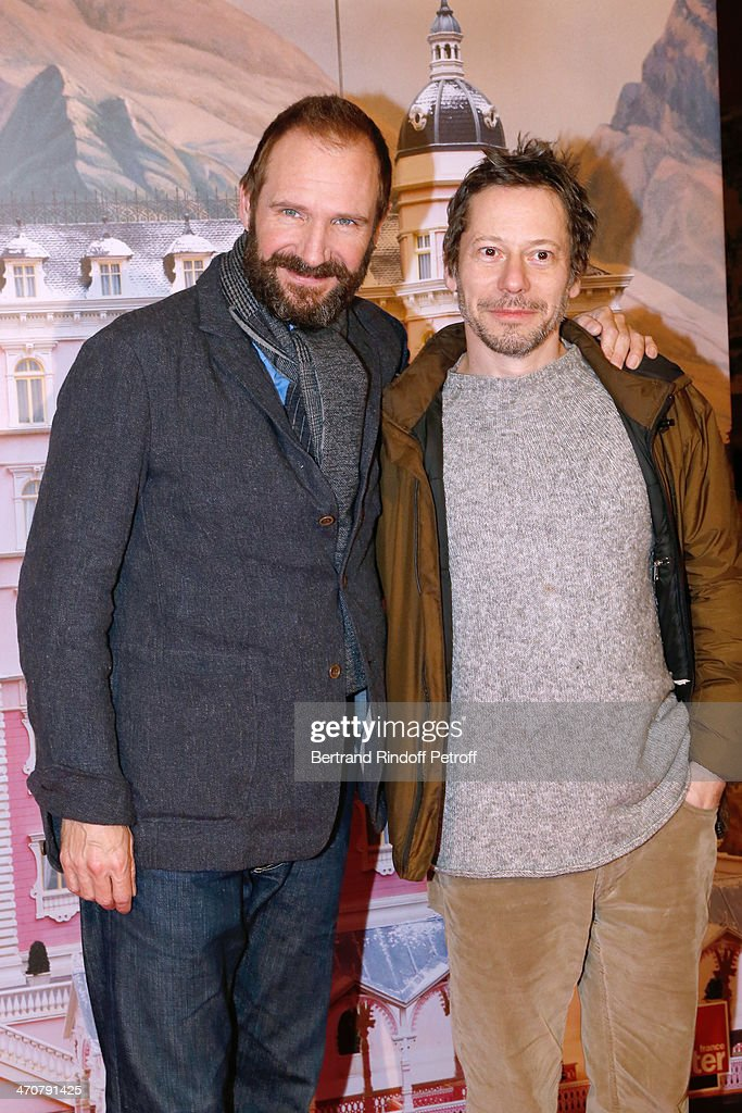 Actors Ralph Fiennes and Mathieu Amalric attend 'The Grand Budapest Hotel' Paris Premiere at Cinema Gaumont Opera Capucines on February 20, 2014 in Paris, France.