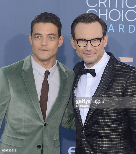 Actors Rami Malek Christian Slater arrives at The 22nd Annual Critics' Choice Awards at Barker Hangar on December 11 2016 in Santa Monica California