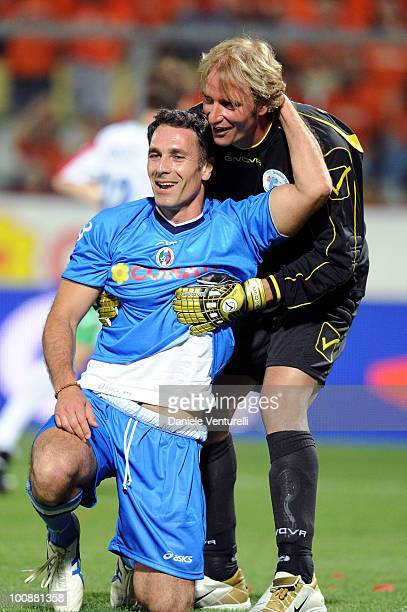 Actors Raoul Bova of Nazionale Cantanti and Massimiliano Rosolino of Telethon Team in action during the XIX Partita Del Cuore charity football game...