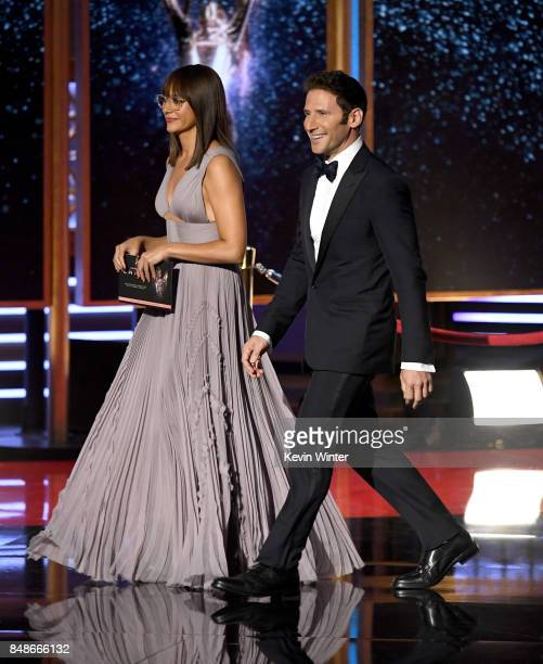 Actors Rashida Jones and Mark Feuerstein walk onstage during the 69th Annual Primetime Emmy Awards at Microsoft Theater on September 17 2017 in Los...