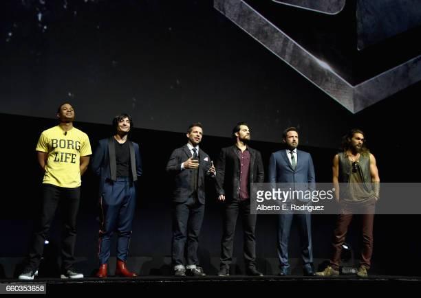 Actors Ray Fisher Ezra Miller director Zack Snyder actors Henry Cavill Ben Affleck and Jason Momoa speak onstage at CinemaCon 2017 Warner Bros...