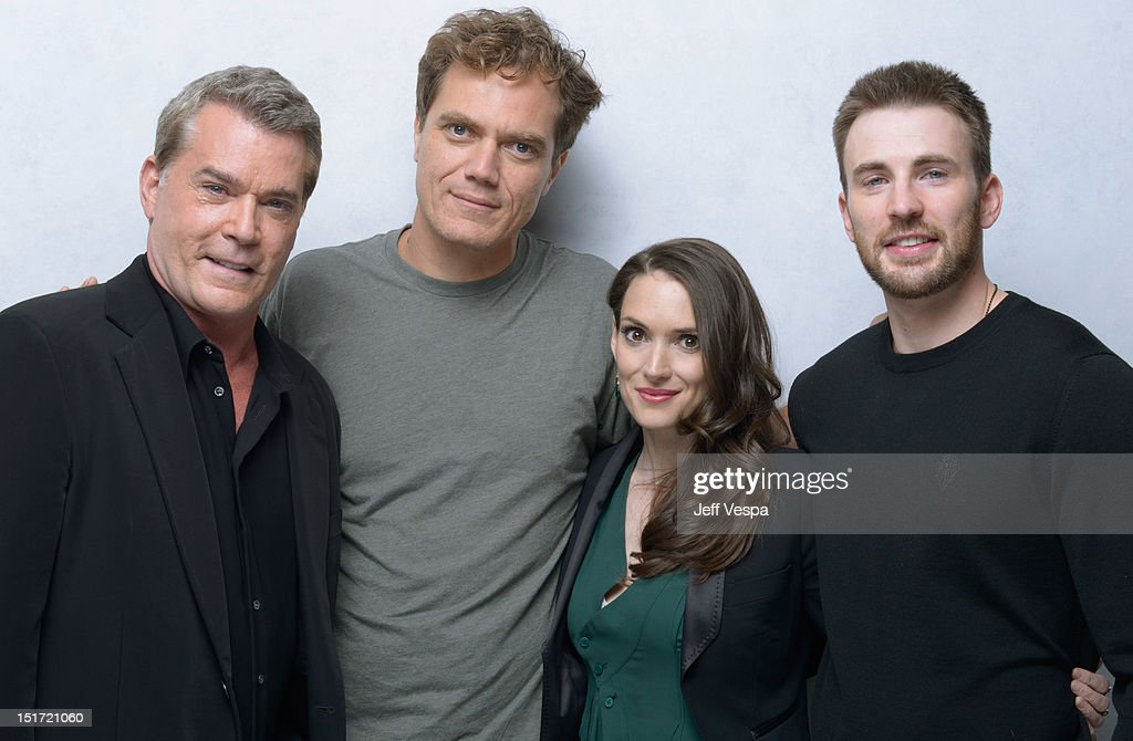 Actors Ray Liotta Michael Shannon Winona Ryder and Chris Evans of 'The Iceman' pose at the Guess Portrait Studio during 2012 Toronto International...