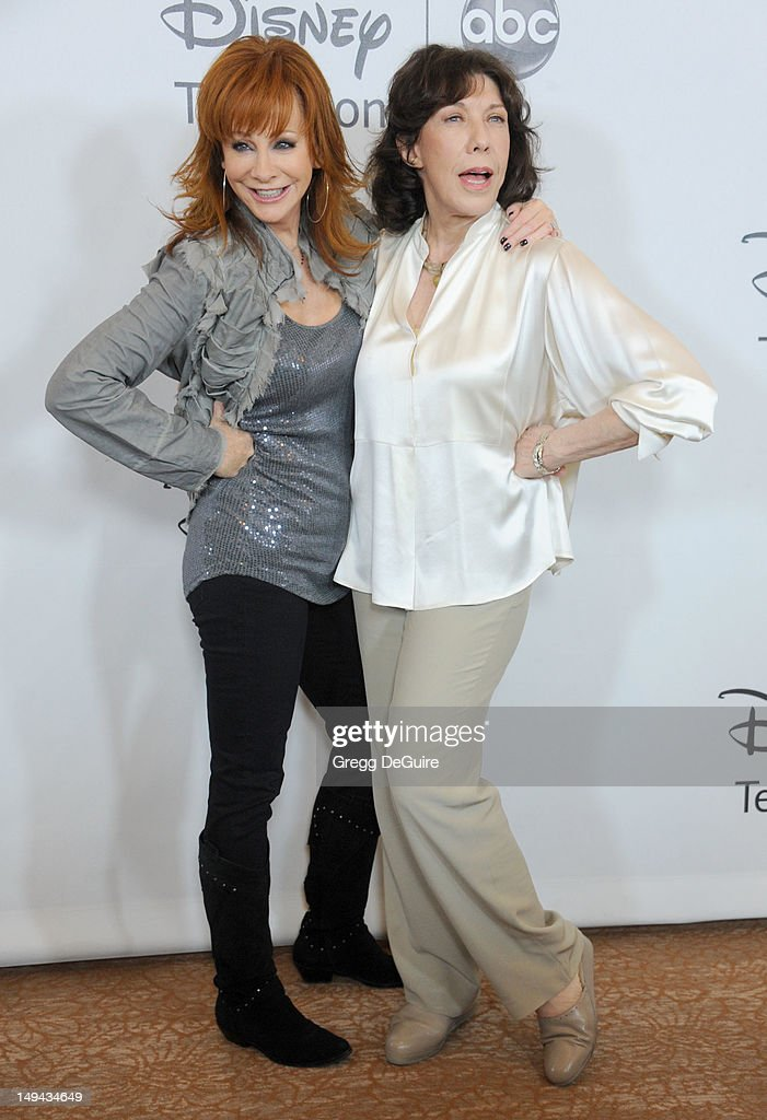 Actors <a gi-track='captionPersonalityLinkClicked' href=/galleries/search?phrase=Reba+McEntire&family=editorial&specificpeople=202959 ng-click='$event.stopPropagation()'>Reba McEntire</a> and <a gi-track='captionPersonalityLinkClicked' href=/galleries/search?phrase=Lily+Tomlin&family=editorial&specificpeople=208236 ng-click='$event.stopPropagation()'>Lily Tomlin</a> arrive at the 2012 Disney ABC Television TCA summer press tour party at The Beverly Hilton Hotel on July 27, 2012 in Beverly Hills, California.