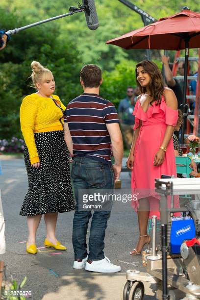 Actors Rebel Wilson Adam DeVine and Priyanka Chopra are seen filming 'Isn't It Romantic' in Central Park on July 11 2017 in New York City
