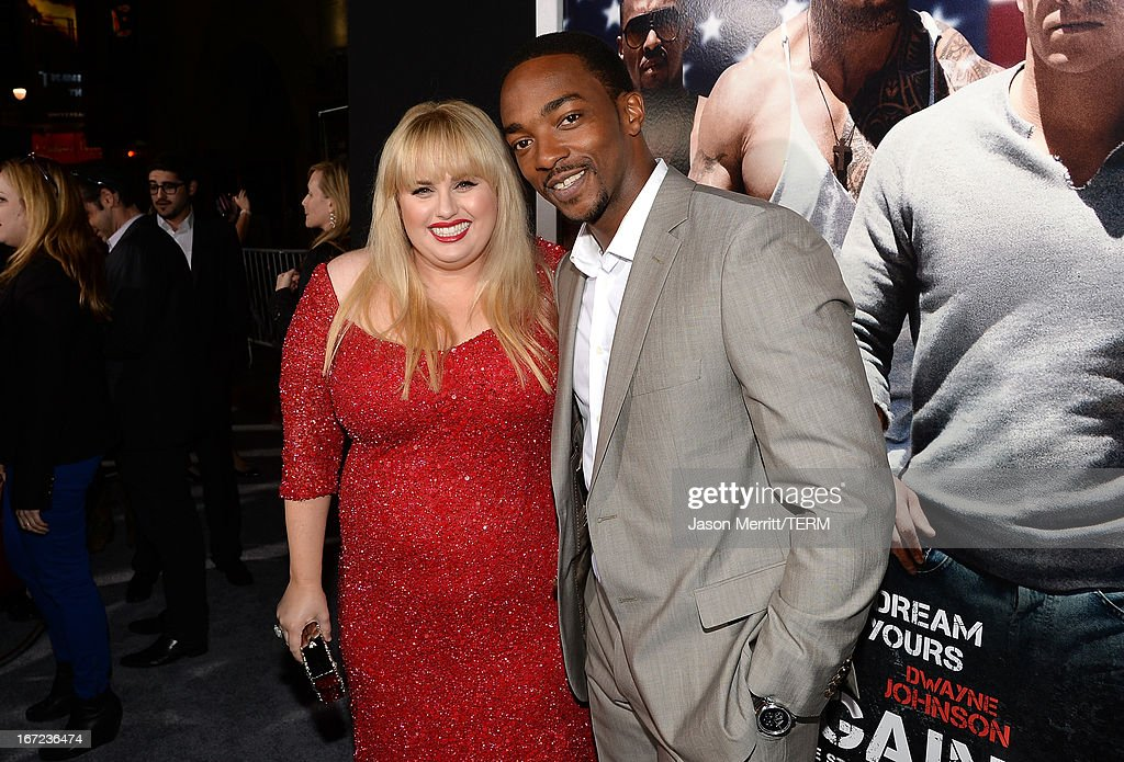 Actors <a gi-track='captionPersonalityLinkClicked' href=/galleries/search?phrase=Rebel+Wilson&family=editorial&specificpeople=5563104 ng-click='$event.stopPropagation()'>Rebel Wilson</a> and <a gi-track='captionPersonalityLinkClicked' href=/galleries/search?phrase=Anthony+Mackie&family=editorial&specificpeople=206212 ng-click='$event.stopPropagation()'>Anthony Mackie</a> arrive at the premiere of Paramount Pictures' 'Pain & Gain' at TCL Chinese Theatre on April 22, 2013 in Hollywood, California.