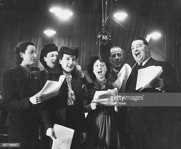 Actors recording the BBC radio show 'It's That Man Again' Joan Harben Diana Morrison Linda Joyce Mollie Weir Hugh Morton and Fred Yule circa 1945