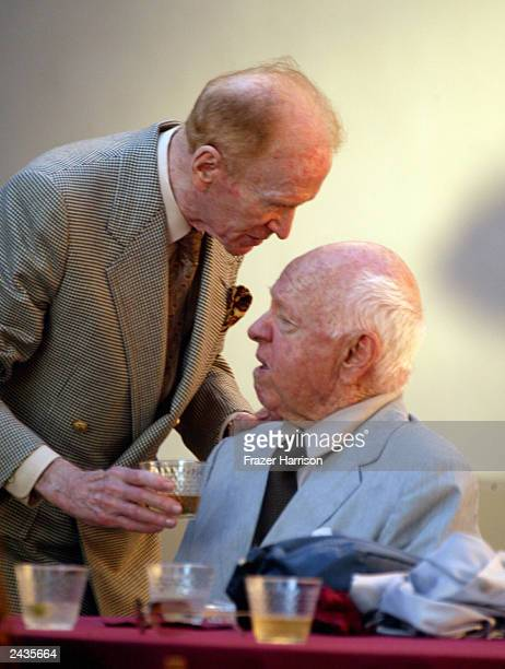 Actors Red Buttons and Micky Rooney speak to one another as they attend the memorial tribute for actor and comedian Bob Hope at the Academy of...