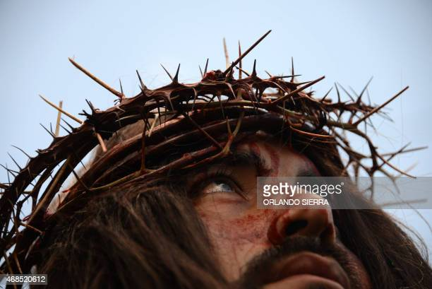 Actors reenact Jesus' Via Crucis during Good Friday in Tegucigalpa on April 3 2015 AFP PHOTO/Orlando SIERRA