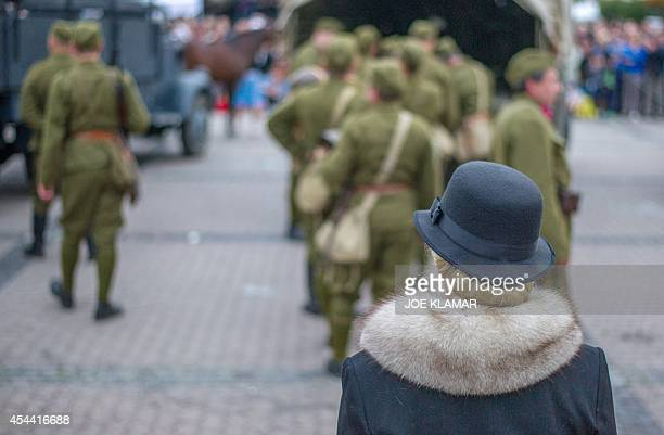 Actors reenact scenes from the mobilisation at the SNP square in the central Slovak town of Banska Bystrica on August 30 2014 to commemorate the 70th...