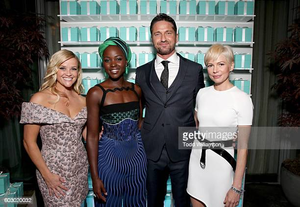 Actors Reese Witherspoon Lupita Nyong'o Gerard Butler and Michelle Williams attend the Vanity Fair and Tiffany Co private dinner toasting Lupita...