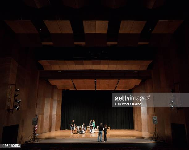 Actors rehearsing on stage