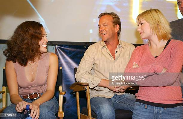 Actors Reiko Aylesworth Kiefer Sutherland and Elisha Cuthbert talk during the 24 hour marathon event in celebration of the September 9 DVD release of...