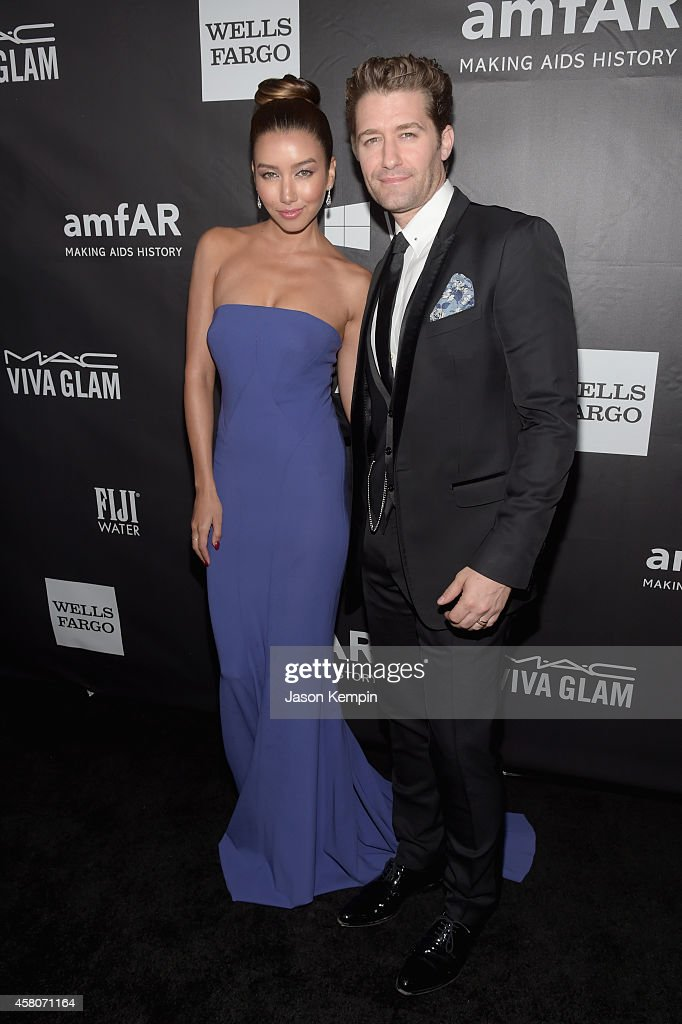 Actors Renee Puente (L) and Matthew Morrison attend amfAR LA Inspiration Gala honoring Tom Ford at Milk Studios on October 29, 2014 in Hollywood, California.