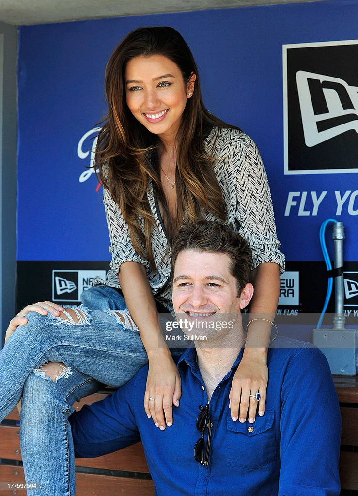 Actors Renee Puente and Matthew Morrison in the Dodger dugout before the game between the Los Angeles Dodgers and the Boston Red Sox at Dodger...