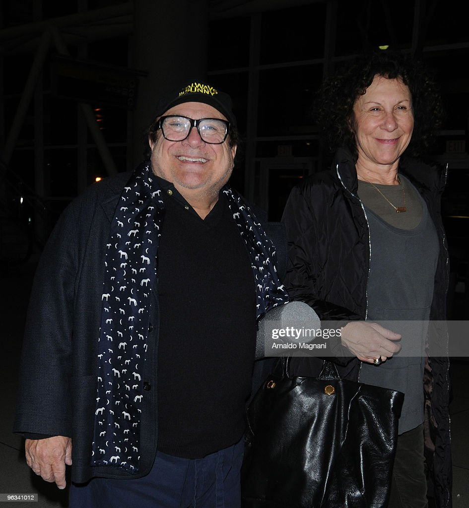 Actors Rhea Perlman and Danny DeVito appear at JFK airport on February 1, 2010 in New York City.