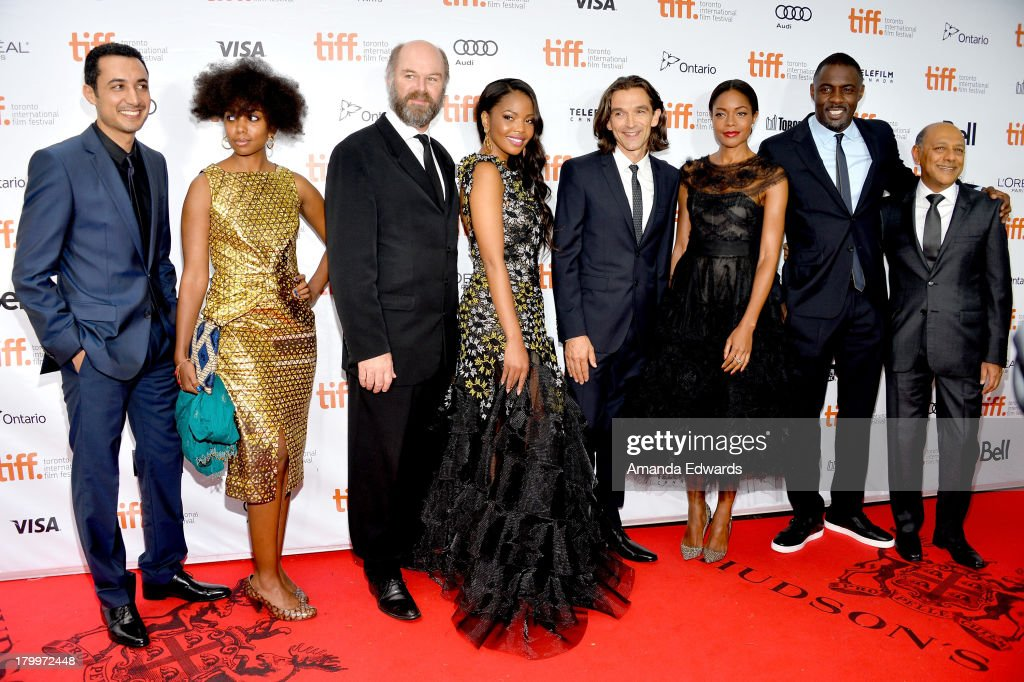 Actors Riaad Moosa, Deon Lotz, Lindiwe Matshikiza, Terry Pheto, director Justin Chadwick, actors Naomie Harris, Idris Elba and producer Anant Singh attend the 'Mandela: Long Walk To Freedom' premiere during the 2013 Toronto International Film Festival at Roy Thomson Hall on September 7, 2013 in Toronto, Canada.