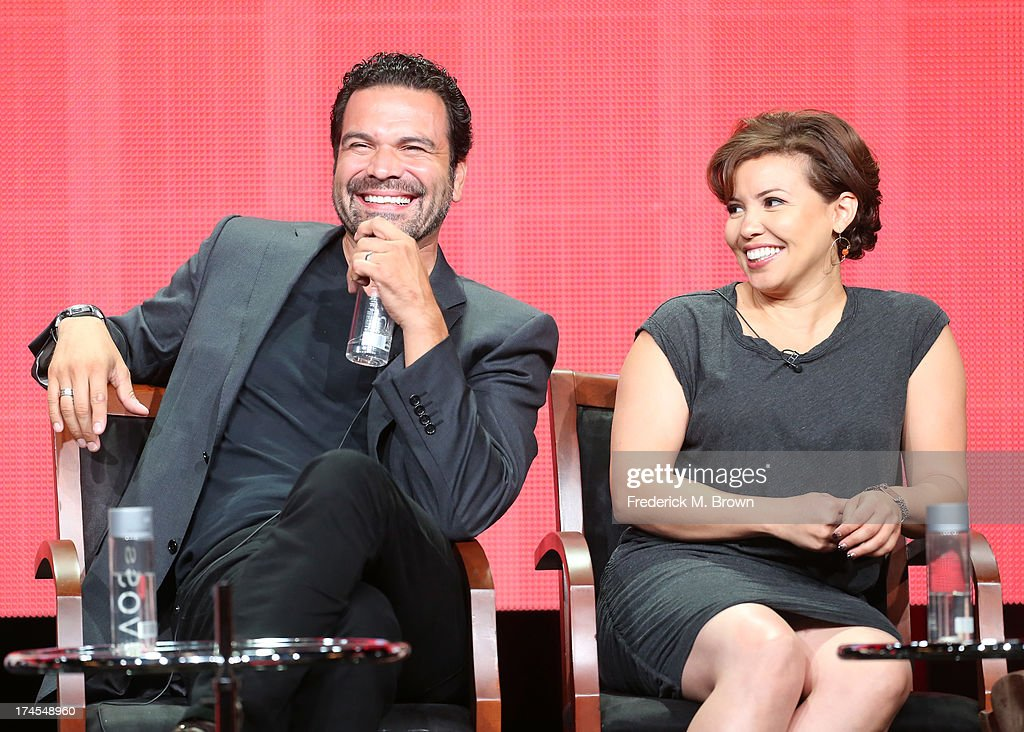 Actors Ricardo Chavira and Justina Machado speak onstage during the 'Welcome to the Family' panel discussion at the NBC portion of the 2013 Summer Television Critics Association tour - Day 4 at the Beverly Hilton Hotel on July 27, 2013 in Beverly Hills, California.