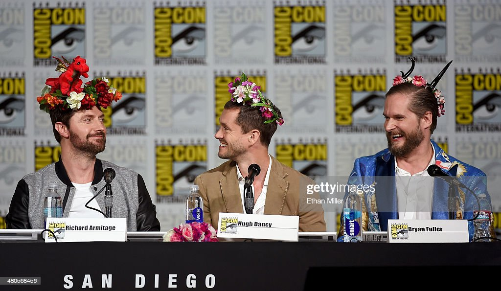 Actors Richard Armitage and Hugh Dancy and executive producer/creator Bryan Fuller wear flower crowns at the 'Hannibal' Savor the Hunt panel during Comic-Con International 2015 at the San Diego Convention Center on July 11, 2015 in San Diego, California.