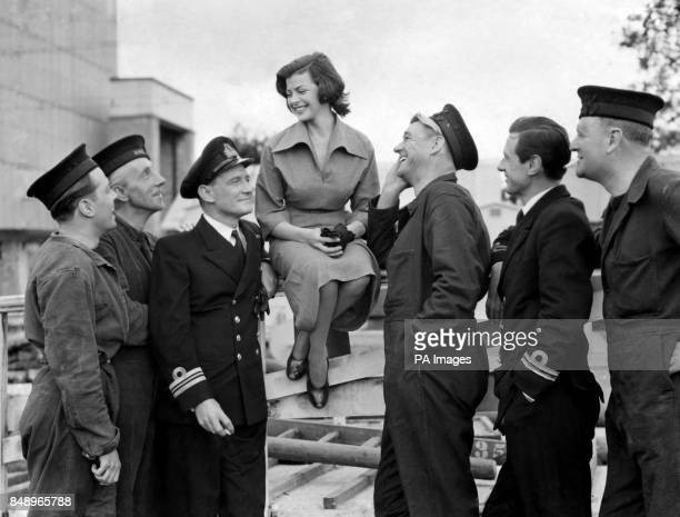 Actors Richard Attenborough Wilfred Hyde White Trevor Howard Sonny Tufts James Donald and Bernard Lee welcome actress Joan Rice to the cast of Gift...