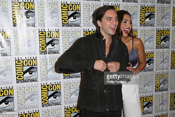 Actors Richard Harmon and Lindsey Morgan of 'The 100' attend ComicCon International 2016 on July 22 2016 in San Diego California