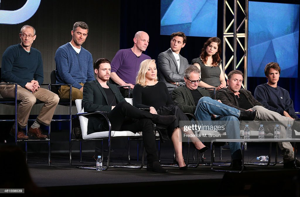 Actors Richard Madden, Abbie Cornish, Sam Shepard, Tim Roth, Johnny Simmons, (back row L-R) David Zucker, Executive Producer, Paul Scheuring, Writer and Executive Producer, and Simon Cellan Jones, Director, and actors Augustus Prew and Conor Leslie, speak onstage during the 'Discovery Channel - Klondike' panel discussion at the Discovery Communications portion of the 2014 Winter Television Critics Association tour at the Langham Hotel on January 9, 2014 in Pasadena, California.