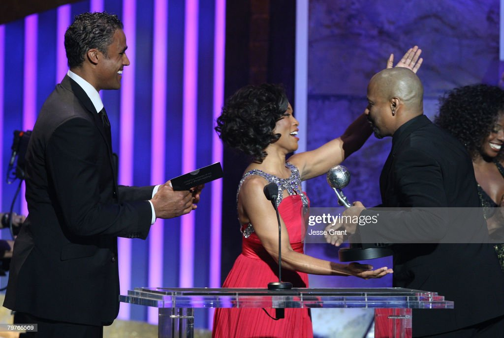 Actors Rick Fox and Angela Bassett present actor Denzel Washington the Outstanding Supporting Actor in a Motion Picture award onstage during the 39th...