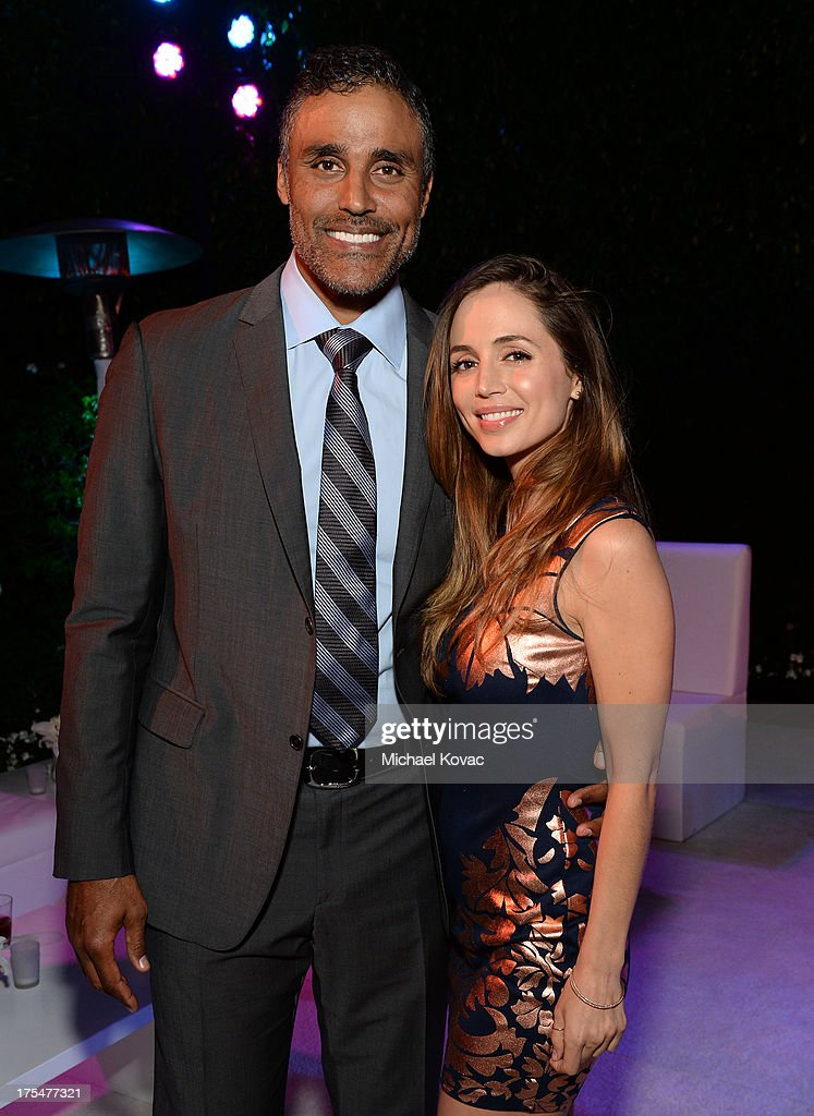 Actors Rick Fox and Eliza Dushku attend the 87th birthday celebration of Tony Bennett and fundraiser for Exploring the Arts, the charity organization founded by Mr. Bennett and wife Susan Benedetto, hosted by Ted Sarandos & Nicole Avant Sarandos among celebrity friends and family on August 3, 2013 in Beverly Hills, California.
