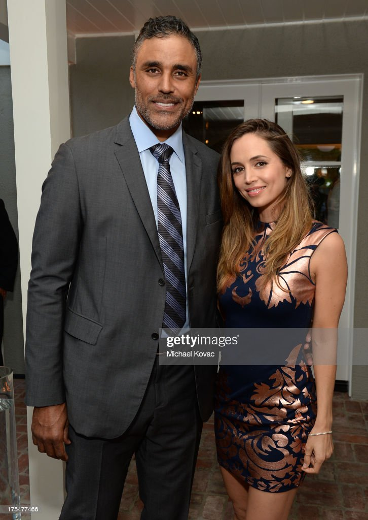 Actors Rick Fox (L) and Eliza Dushku attend the 87th birthday celebration of Tony Bennett and fundraiser for Exploring the Arts, the charity organization founded by Mr. Bennett and wife Susan Benedetto, hosted by Ted Sarandos & Nicole Avant Sarandos among celebrity friends and family on August 3, 2013 in Beverly Hills, California.