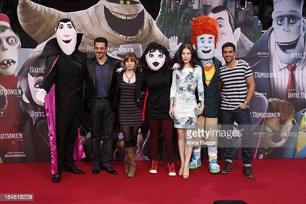Actors Rick Kavanian Josefine Preuss Nora von Waldstaetten and Elyas MBarek attend the 'Hotel Transsilvanien' Germany premiere at Cinemaxx on October...