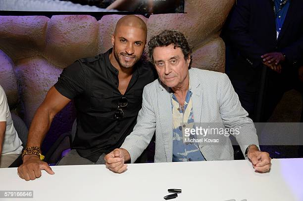 Actors Ricky Whittle and Ian McShane attend the 'American Gods' autograph signing during ComicCon International at San Diego Convention Center on...