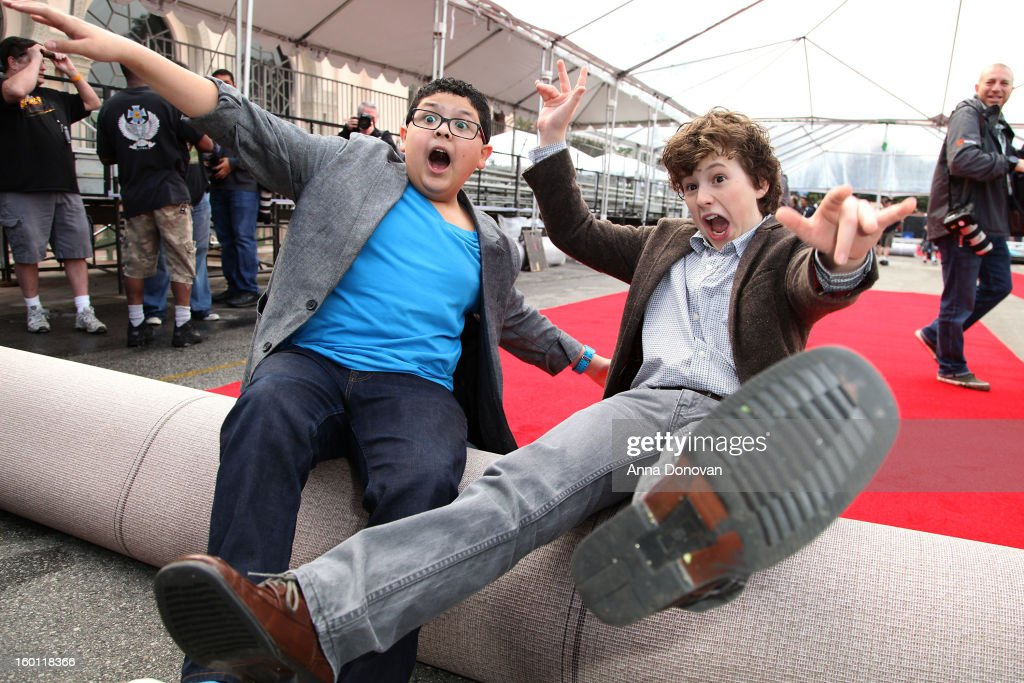 Actors Rico Rodriguez (L) and <a gi-track='captionPersonalityLinkClicked' href=/galleries/search?phrase=Nolan+Gould&family=editorial&specificpeople=5691358 ng-click='$event.stopPropagation()'>Nolan Gould</a> participating in the Red Carpet Roll Out for The 19th Annual Screen Actors Guild Awards at The Shrine Expo Hall on January 26, 2013 in Los Angeles, California.