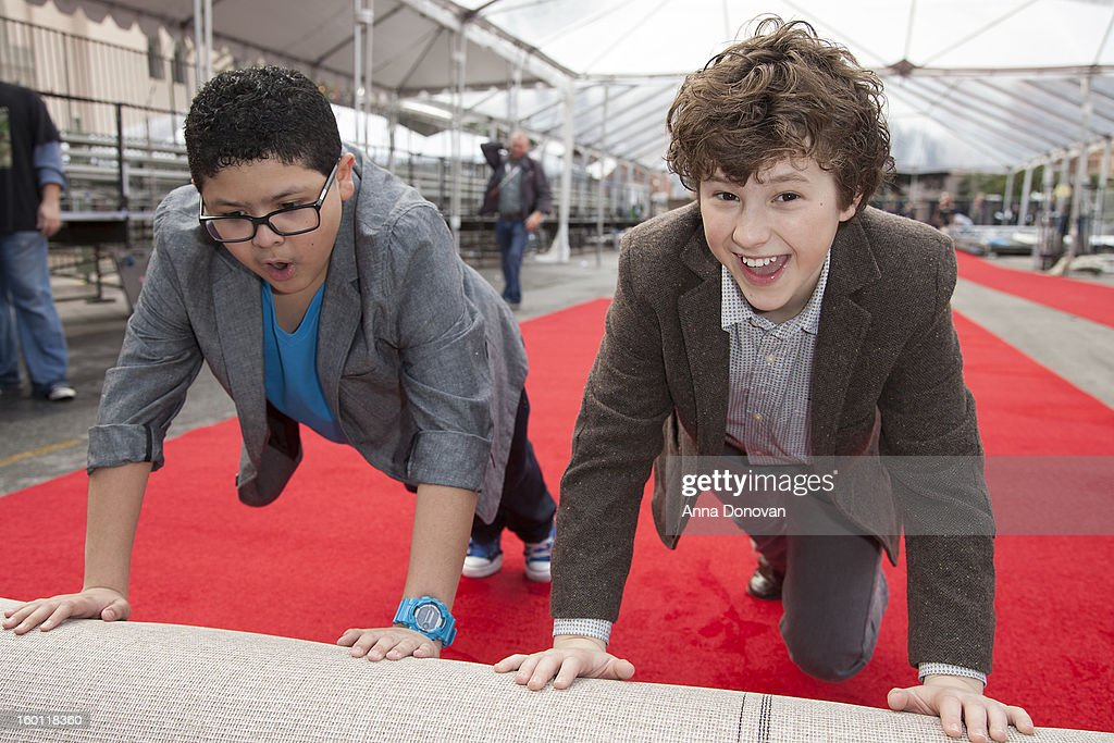 Actors Rico Rodriguez (L) and <a gi-track='captionPersonalityLinkClicked' href=/galleries/search?phrase=Nolan+Gould&family=editorial&specificpeople=5691358 ng-click='$event.stopPropagation()'>Nolan Gould</a> participationg in the red carpet roll out for The 19th Annual Screen Actors Guild Awards at The Shrine Expo Hall on January 26, 2013 in Los Angeles, California.