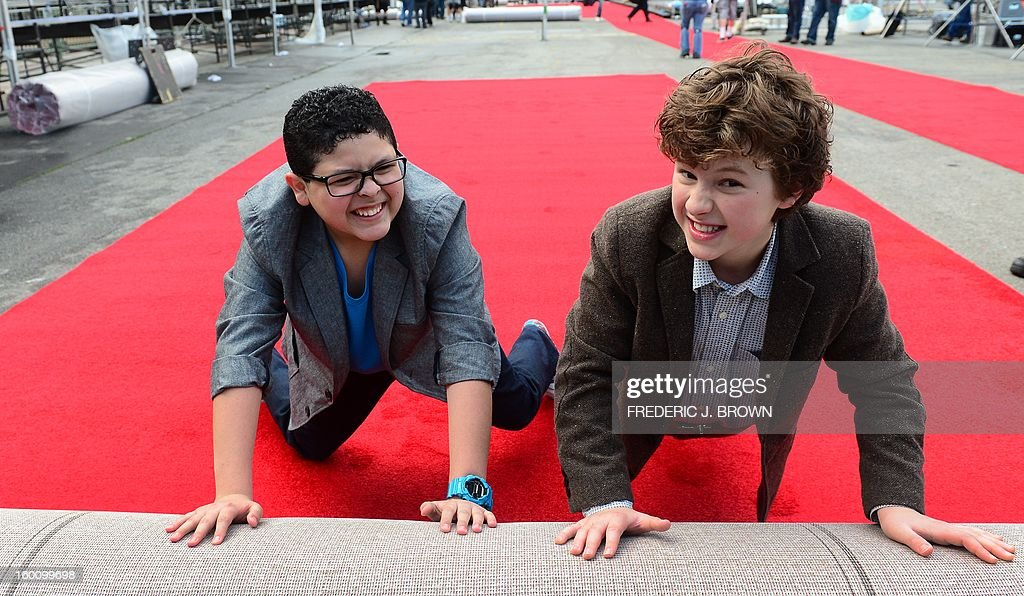 Actors Rico Rodriguez (L) and Nolan Gould (R) play for the cameras while rolling out the red carpet in Los Angeles on January 26, 2013 during preparations ahead of the 19th Annual Screen Actors Guild (SAG) Awards on January 27. AFP PHOTO/Frederic J. BROWN